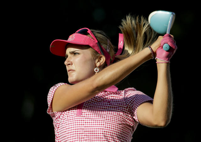 Lexi Thompson watches her tee shot on the 16th hole during the third round of the Kraft Nabisco Championship golf tournament on Saturday, April 5, 2014 in Rancho Mirage, Calif. (AP Photo/Chris Carlson)