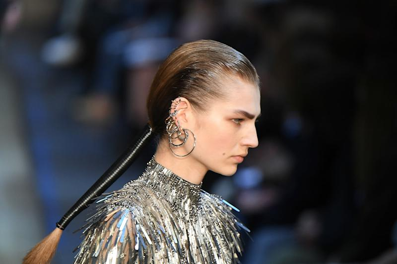 Alexander McQueen's subversive beauty code—glossy, androgynous hair offset by fairy-tale femininity below the neck—is holding steady.