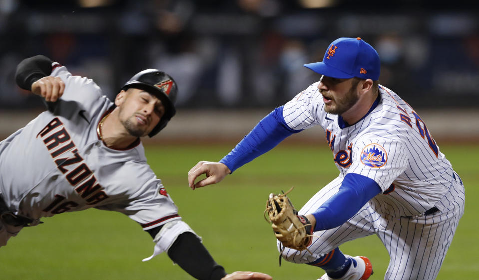 New York Mets first baseman Pete Alonso (20) tags out Arizona Diamondbacks' Tim Locastro (16) during the seventh inning of a baseball game Saturday, May 8, 2021, in New York. (AP Photo/Noah K. Murray)