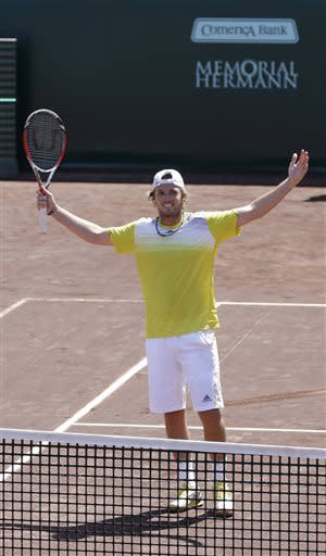 Rhyne Williams, of the United States, celebrates after defeating Ruben Ramirez Hidalgo, of Spain, 7-6 (1), 1-6, 6-4, in their quarterfinal tennis match at the U.S. Men's Clay Court Championship Friday, April 12, 2013, in Houston. (AP Photo/Pat Sullivan)