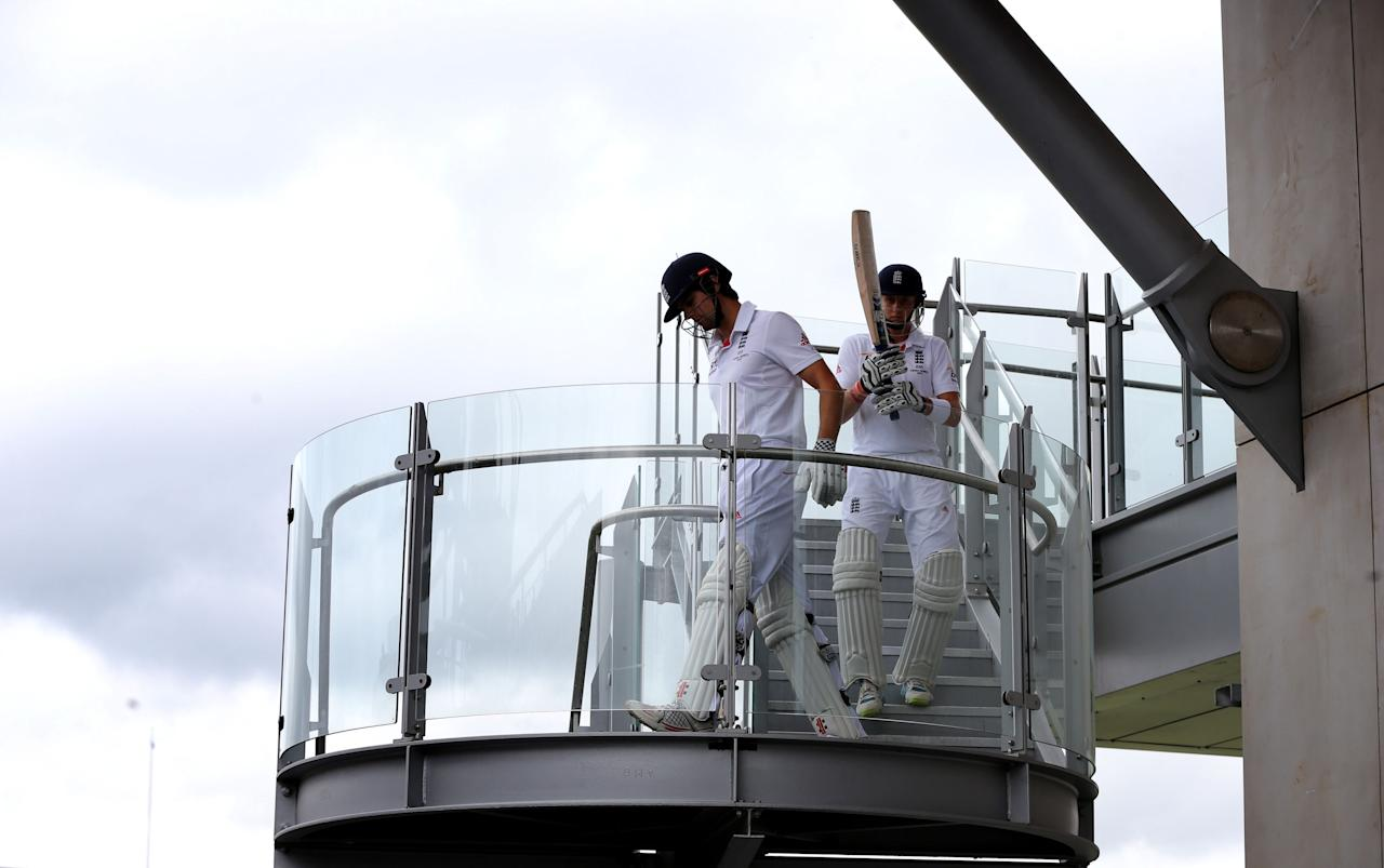 England captain Alastair Cook and Joe Root opening pair at start of day five of the Third Investec Ashes test match at Old Trafford Cricket Ground, Manchester.