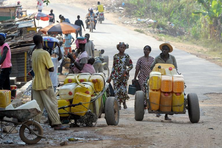 Street vendors sell water in a street in Gueckedou, southern Guinea on April 1, 2014