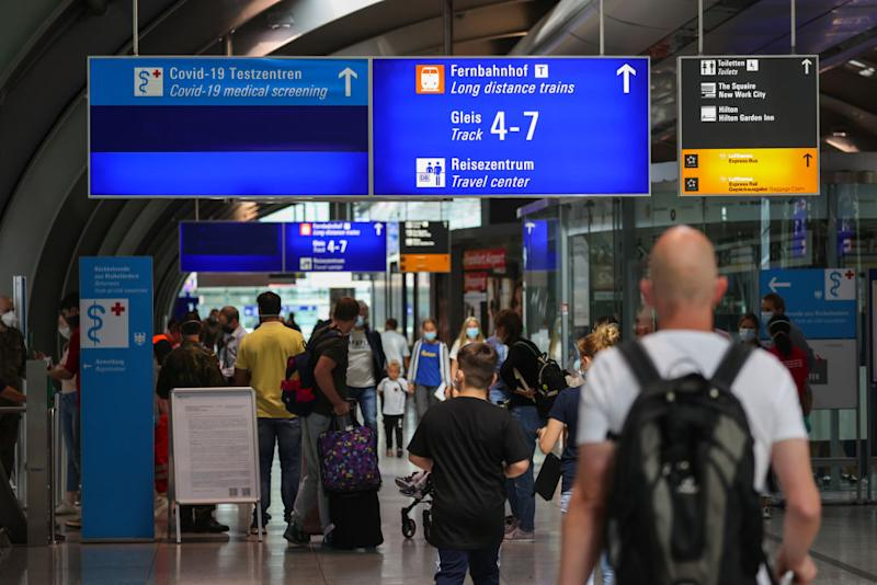 A sign directs travelers to a Covid-19 test center, operated by Centogene NV, at Frankfurt Airport in Frankfurt, Germany, on Thursday, Aug. 27, 2020. A spat has broken out between senior officials in Chancellor Angela Merkel's conservative bloc over coronavirus rules for travelers arriving in Germany from areas designated as risky. Photographer: Alex Kraus/Bloomberg