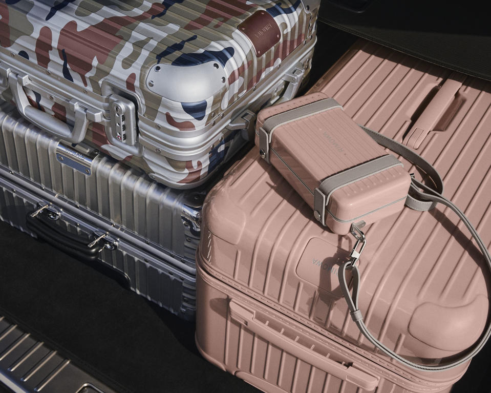 Essential Trunk Plus, Classic Check-in Silver, Personal in Desert Rose and Original Cabin in Pink Camouflage. (PHOTO: Rimowa)