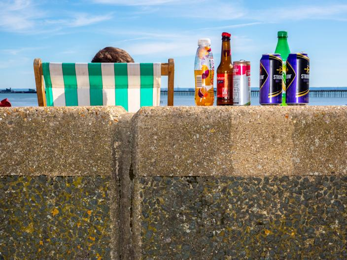 SOUTHEND, ENGLAND - MAY 20: Empty alcohol containers on the wall next to the beach on May 20, 2020 in Southend, United Kingdom. Parts of the country were expected to reach 29 degrees celsius, luring sunbathers and testing the capacity of parks and beaches to accommodate social distanced crowds. (Photo by Peter Dench/Getty Images)
