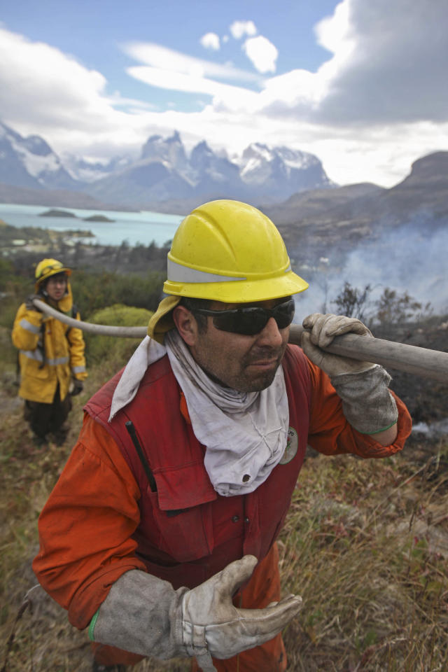 Firefighters work in an area of the Torres del Paine national park in Torres del Paine, Chile, Sunday Jan 1, 2012. Firefighters are making progress against a major blaze that has burned more 48 square miles (12,500 hectares) in one of Chile's most spectacular national parks. The Israeli tourist accused of setting the fire denied guilt. (AP Photo)
