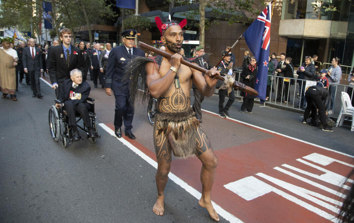 A New Zealand Maori warrior marches during the Anzac Day parade in Sydney, Australia, Sunday, April 25, 2021. Australians and New Zealanders paid tribute to their war dead Sunday as both nations prepared to withdraw from their longest war in Afghanistan. (AP Photo/Mark Baker)