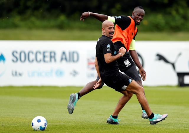 Soccer Football - England & Soccer Aid World XI Training - Motspur Park, London, Britain - June 7, 2018 Soccer Aid World XI's Usain Bolt and Juan Sebastian Veron during training Action Images via Reuters/Andrew Boyers