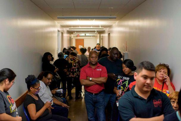 PHOTO: Voters line up at a polling station to cast their ballots during the presidential primary in Houston, Texas on Super Tuesday, March 3, 2020. (Mark Felix/AFP via Getty Images)