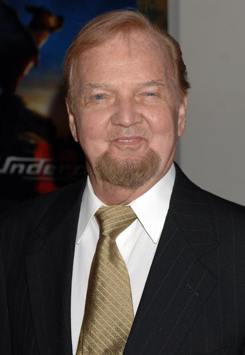 "FILE - In this July 30, 2007 file photo, William Watts Biggers arrives for the premiere of the ""Underdog"" movie in New York. Biggers, the co-creator of the cartoon ""Underdog,"" the mild-mannered shoeshine boy who turned into a caped superhero to rescue his girlfriend, Sweet Polly Purebred, has died, he was 85. Family friend Derek Tague says Biggers, who went by ""Buck,"" died unexpectedly at his Plymouth, Mass., home on Sunday, Feb. 10, 2013. The native of Avondale Estates, Ga., worked for the New York City advertising firm DFS when he accepted an assignment from the agency's largest client, General Mills, to create television cartoons to promote its breakfast cereals. The most famous was ""Underdog,"" which debuted on NBC in 1964. (AP Photo/Henny Ray Abrams)"