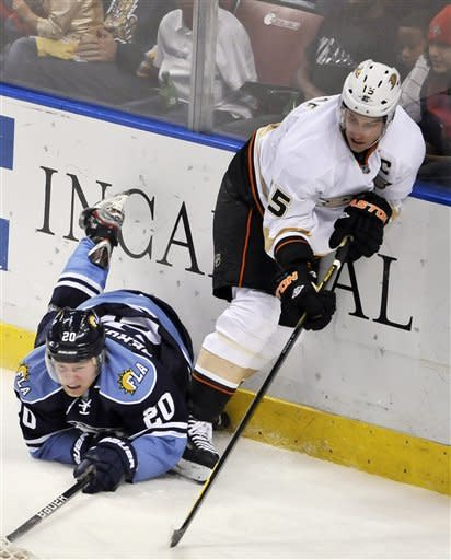 Anaheim Ducks' Ryan Getzlaf (15) is checked by Florida Panthers' Sean Bergenheim (20) during the second period of an NHL hockey game on Sunday, Feb. 19, 2012, in Sunrise, Fla. (AP Photo/Gary I Rothstein)