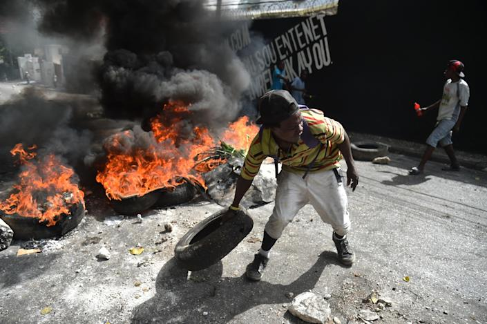<p>Protesters barricade a street in the Port-au-Prince suburb of Petion-Ville on July 7, 2018, to protest against the increase in fuel prices. (Photo: Hector Retamal/AFP/Getty Images) </p>