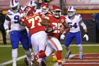 Kansas City Chiefs running back Clyde Edwards-Helaire (25) scores on a 1-yard touchdown run during the first half of the AFC championship NFL football game against the Buffalo Bills, Sunday, Jan. 24, 2021, in Kansas City, Mo. (AP Photo/Orlin Wagner)