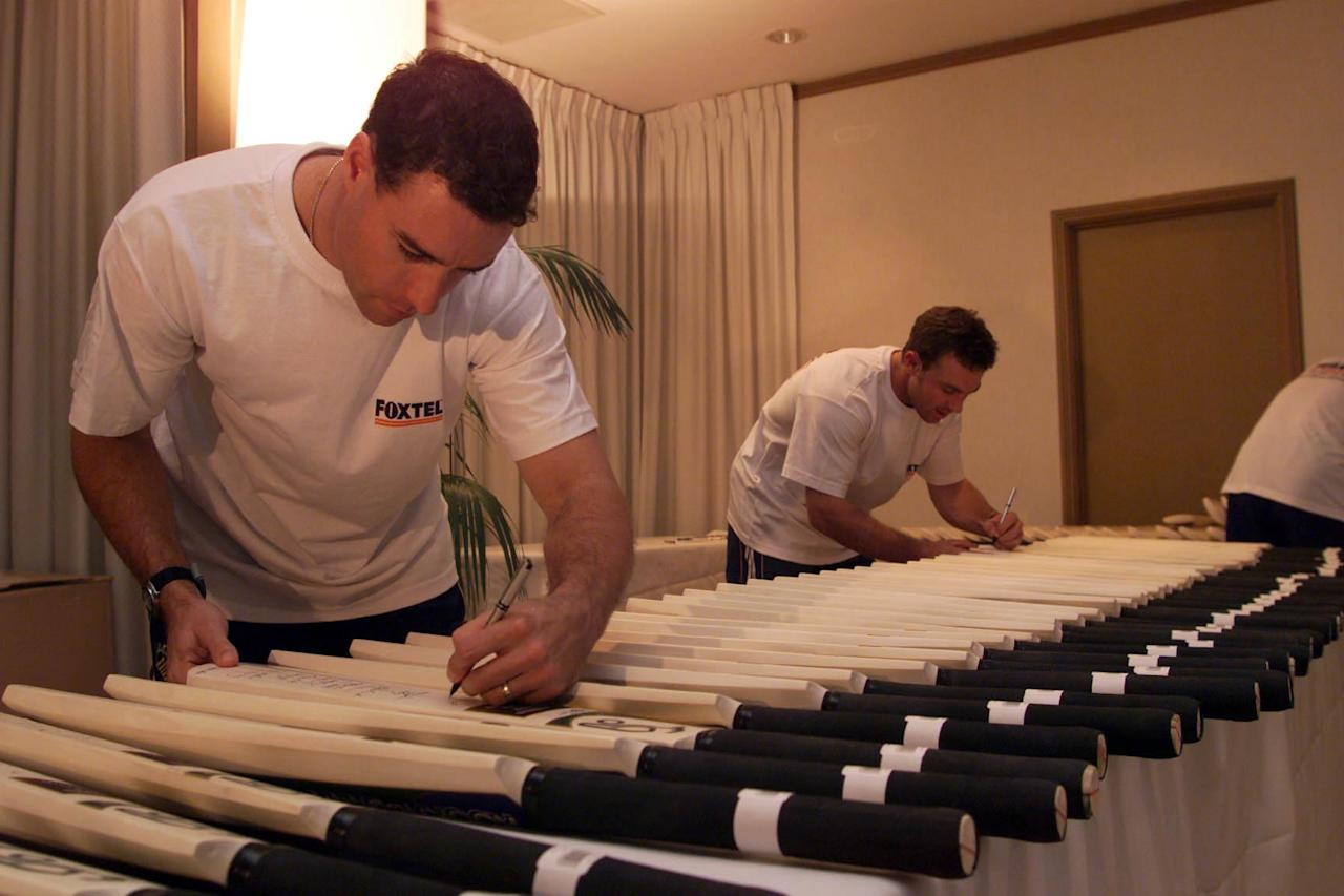 13 Aug 1999: Michael Bevan (left) and Michael Slater (right) of Australia, sign cricket bats, during the Pre Season Training Camp at the Sheraton Hotel, Brisbane, Australia. Mandatory Credit: Hamish Blair/ALLSPORT