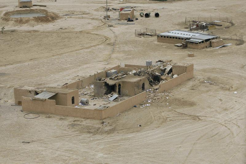 FILE - In this Wednesday, April 21, 2010 file photo, general view of the site of a joint U.S-Iraqi raid on a safe house that killed Abu Omar al-Baghdadi and Abu Ayyub al-Masri, two top-ranking al-Qaida figures, about six miles (10 kilometers) southwest of Tikrit. The first online statement from the new leader of al-Qaida's affiliate in Iraq claims that the militant network is returning to the old strongholds from which it was driven by U.S. forces and their Sunni allies prior to the American withdrawal at the end of last year, and that it is preparing operations to free prisoners and assassinate court officials. (AP Photo/Karim Kadim, File)