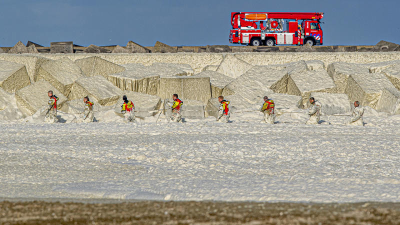 The coastguard, police and fire brigade, pictured here searching for the missing surfers.