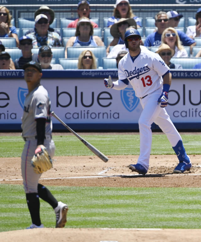 Los Angeles Dodgers' Max Muncy, right, drops his bat after hitting a solo home run as Miami Marlins starting pitcher Jordan Yamamoto watches during the first inning of a baseball game Sunday, July 21, 2019, in Los Angeles. (AP Photo/Mark J. Terrill)