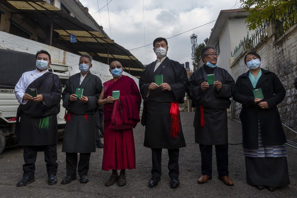 Lobsang Sangay, third from right, the president of the Tibetan government-in-exile serving his second and final term, poses for a photograph with some of his cabinet members after casting his vote in Dharmsala, India, Sunday, Jan. 3, 2021. Exile Tibetans Sunday voted in the first round to elect a new political leader and members of the Tibetan parliament in exile. (AP Photo/Ashwini Bhatia)