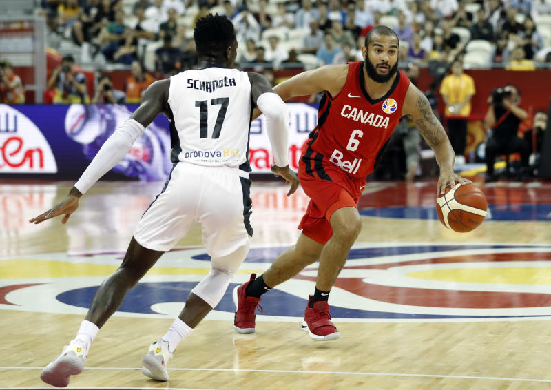 Basketball - FIBA World Cup - Classification Round 17-32 - Group P - Germany v Canada - Shanghai Oriental Sports Center, Shanghai, China - September 9, 2019 Germany's Dennis Schroder in action with Canada's Cory Joseph REUTERS/Aly Song