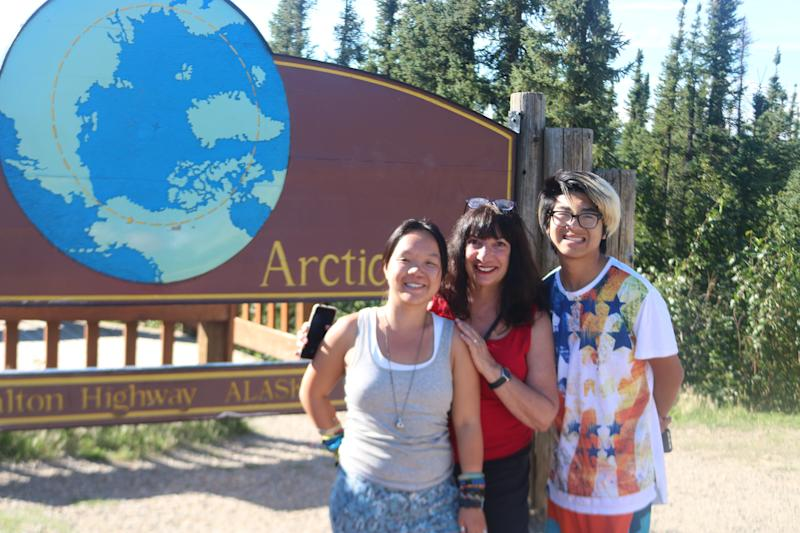 The author and her children in front of the marker for the Arctic Circle. (Courtesy of Ann Brenoff)