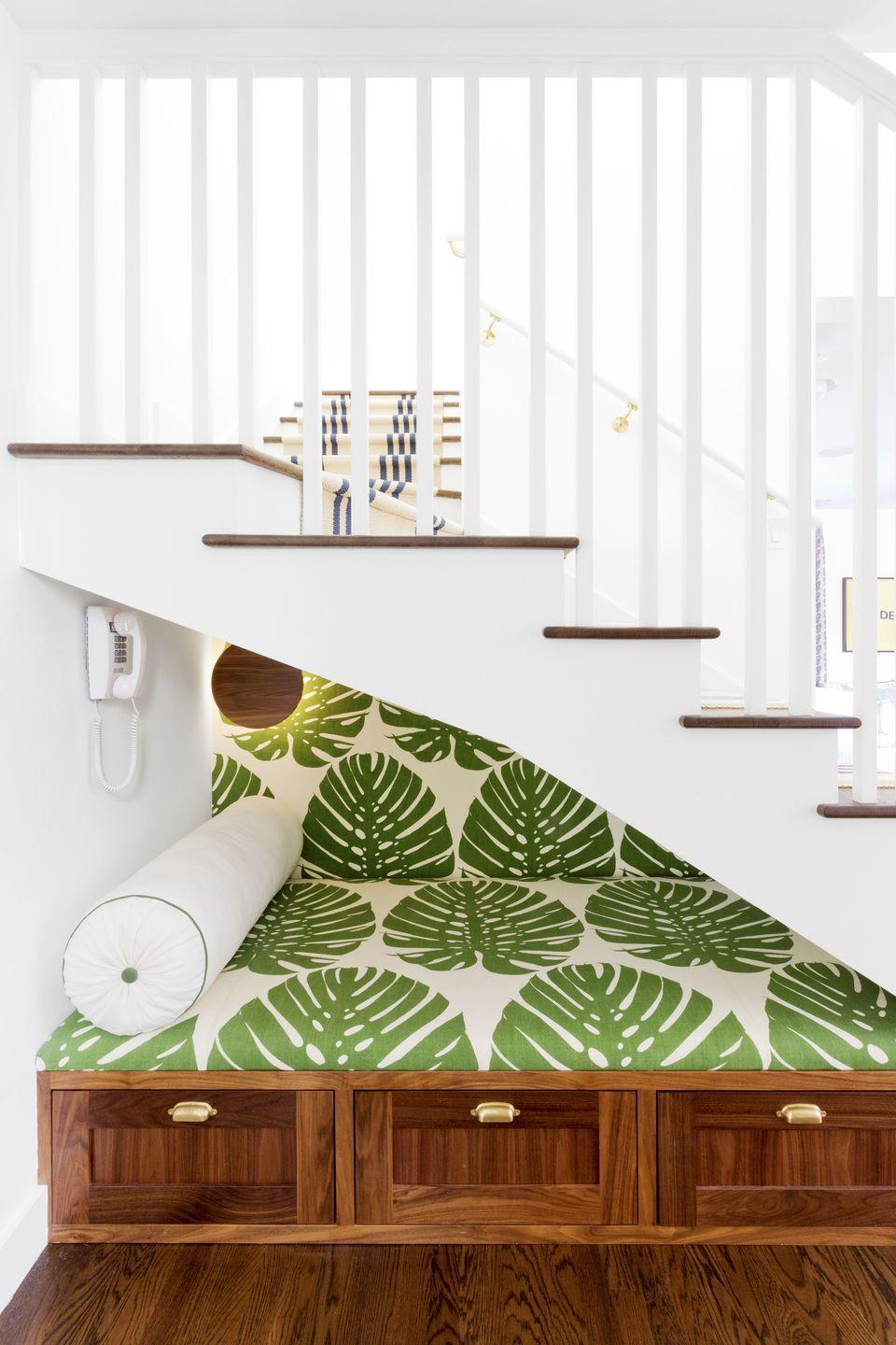 <p>Create an easy spot to tuck away the clutter that tends to build up at the bottom of the stairs. Designer Amy Sklar and architect Barbara Bestor teamed up to make this nifty nap nook, complete with extra deep drawers. </p>