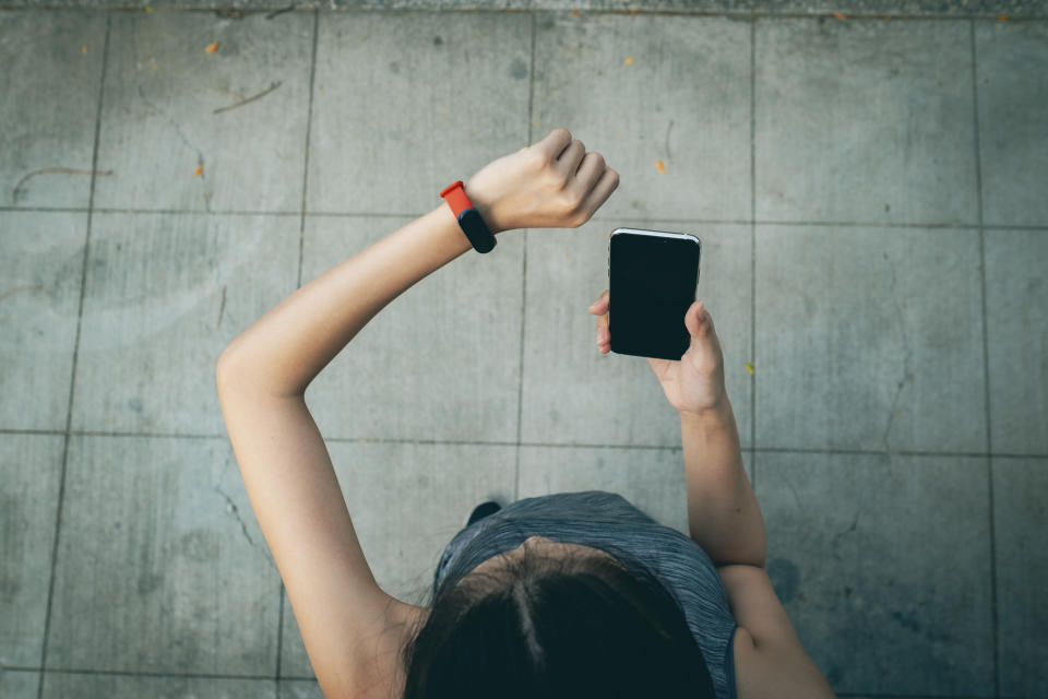Young sporty woman checking her smart watch