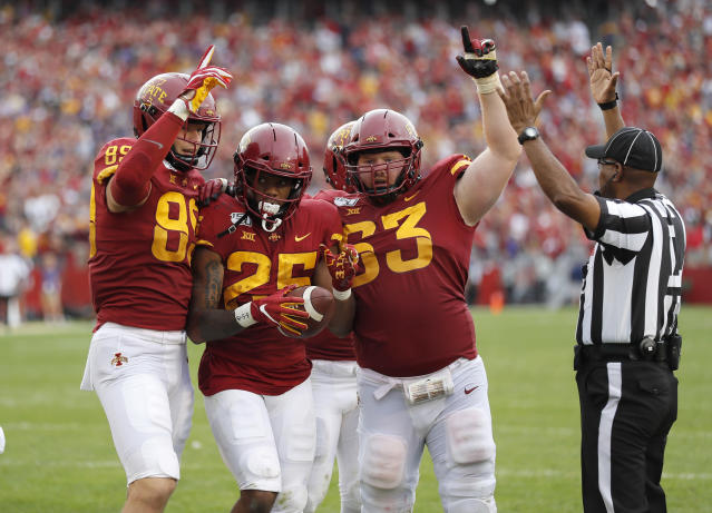 Iowa State's Brian Papazian, left, Sheldon Croney, center, and Collin Olson, right, celebrates Croney's winning touchdown during the third overtime of a NCAA college football game against Northern Iowa, Saturday, Aug. 31, 2019, in Ames. Iowa State won 29-26 in a third overtime. (AP Photo/Matthew Putney)