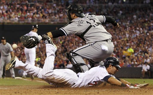 Minnesota Twins' Darin Mastroianni slides safely into home against Chicago White Sox catcher A.J. Pierzynski (12) during the sixth inning of a baseball game, Tuesday, July 31, 2012, in Minneapolis. (AP Photo/Genevieve Ross)