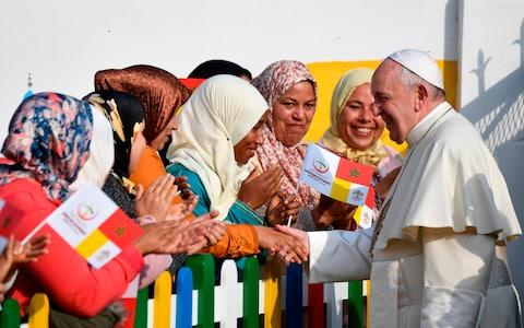 Pope Francis greets locals during a visit to the Rural Centre for Social Services - Credit: ALBERTO PIZZOLI/AFP/Getty Images