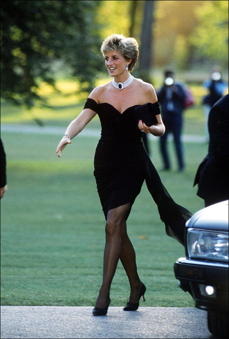 """<p><a href=""""https://www.popsugar.com/fashion/Iconic-Princess-Diana-Outfits-43937117"""" class=""""link rapid-noclick-resp"""" rel=""""nofollow noopener"""" target=""""_blank"""" data-ylk=""""slk:Princess Diana's Christina Stambolian gown"""">Princess Diana's Christina Stambolian gown</a> has infamously been dubbed """"the revenge dress,"""" as she wore it after separating from Prince Charles. The people's princess elevated this outfit with a pearl choker and sheer tights for an effortlessly sexy look. </p>"""