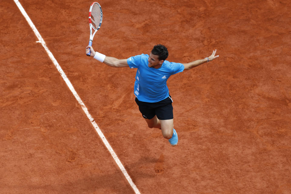 FILE - In this June 9, 2019, file photo, Austria's Dominic Thiem returns the ball to Spain's Rafael Nadal during the men's final match of the French Open tennis tournament at Roland Garros stadium in Paris. (AP Photo/Pavel Golovkin, File)