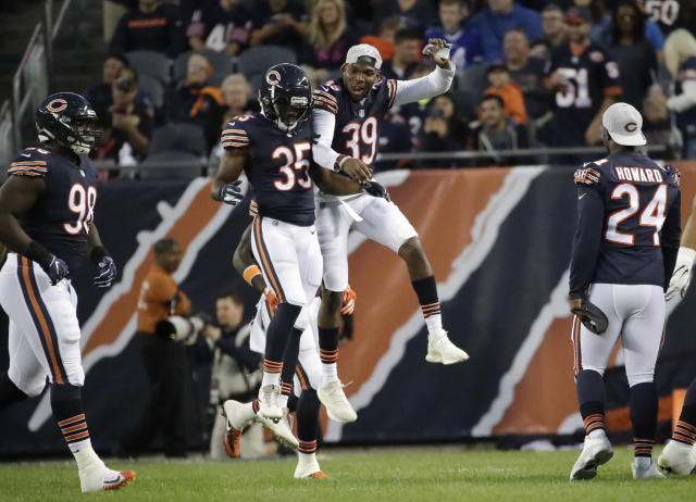 Chicago Bears cornerback Doran Grant (35) celebrates a touchdown on an interception runback with defensive back Eddie Jackson (39) during the first half of an NFL preseason football game against the Buffalo Bills in Chicago, Thursday, Aug. 30, 2018. (AP Photo/Nam Y. Huh)