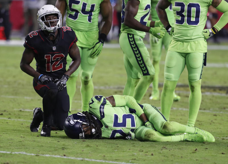 Seattle Seahawks cornerback Richard Sherman (25) lies on the turf after suffering an injury against the Cardinals. (AP)