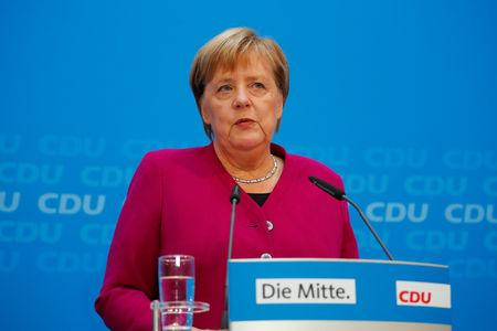 German conservatives' new floor leader downplays blow to Merkel