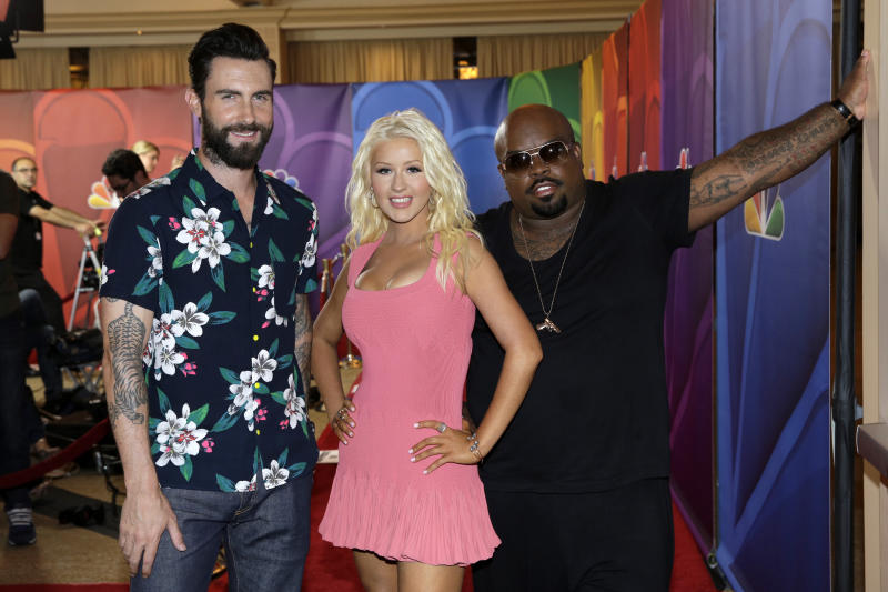 "This image released by NBC shows judges, from left, Adam Levine, Christina Aguilera, and CeeLo Green at ""The Voice"" session during the NBCUniversal Press Tour in Beverly Hills, Calif., on Saturday, July 27, 2013. (AP Photo/NBC, Paul Drinkwater)"