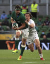 Ireland's Caelan Doris, left, is tackled by USA's Michael Baska, during the Rugby Union International Summer Series match between Ireland and USA, in Dublin, Ireland, Saturday July 10, 2021. (Donall Farmer/PA via AP)