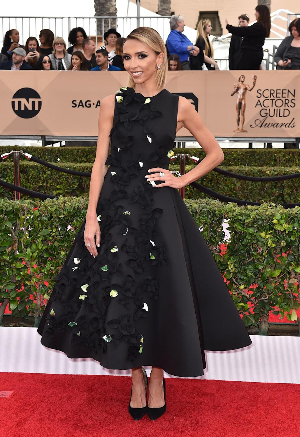 """<p>The host of <i>E's </i>red carpet show broke the gown trend by wearing a tea-length dress. Brad Goreski, her co-host, said that """"not wearing a full length gown which could be the chicest thing of all."""" <i>Photo: AP</i></p>"""