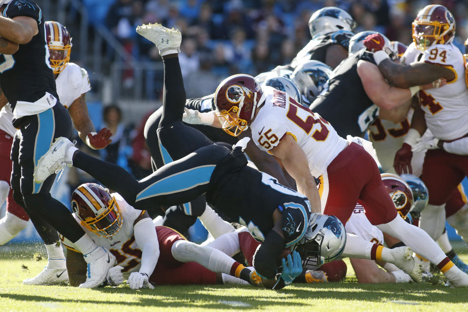 Carolina Panthers wide receiver Curtis Samuel (10) dives while Washington Redskins linebacker Cole Holcomb (55) degends during the first half of an NFL football game in Charlotte, N.C., Sunday, Dec. 1, 2019. (AP Photo/Brian Blanco)