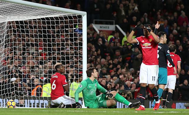 "<a class=""link rapid-noclick-resp"" href=""/soccer/players/anthony-martial/"" data-ylk=""slk:Anthony Martial"">Anthony Martial</a> (right) reacts after Paul Pogba's goal was ruled out for offside. Manchester United was held to a 0-0 draw by Southampton. (Getty)"