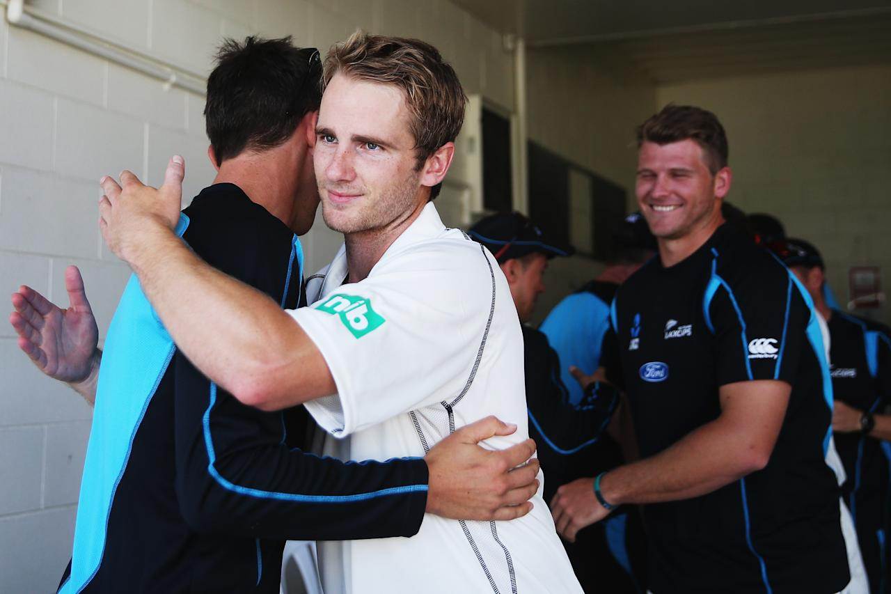 HAMILTON, NEW ZEALAND - DECEMBER 22: Kane Williamson of New Zealand celebrates with Trent Boult after winning the Third Test match between New Zealand and the West Indies at Seddon Park on December 22, 2013 in Hamilton, New Zealand.  (Photo by Hannah Johnston/Getty Images)