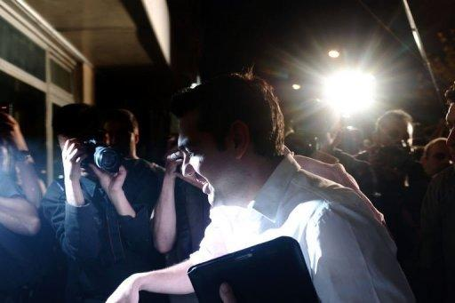 Leader of the leftist coalition Syriza, Alexis Tsipras, arrives at the coalition headquarters in Athens. Greek voters dealt a blow to eurozone hopes that Athens will stick to its austerity commitments as parties opposing more cuts, including neo-Nazis, won almost 60-percent support in an election Sunday