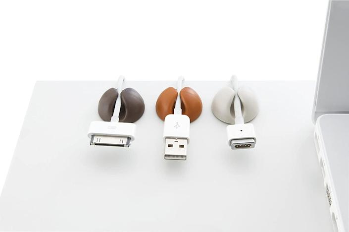 <p>Say goodbye to a tangle of cords with the <span>Bluelounge CableDrops</span> ($10). These items stick to any surface and will keep your cord tangle-free.</p>
