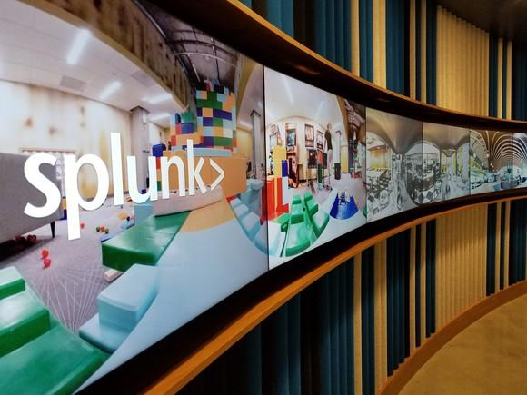 Splunk logo displayed at headquarters office on an array of flat-screen TVs.