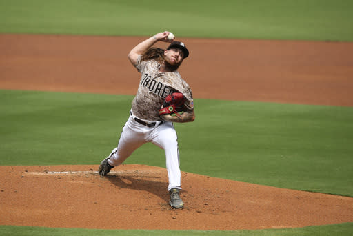 San Diego Padres starting pitcher Mike Clevinger (52) delivers a pitch during the first inning of a baseball game Sunday, Sept. 13, 2020, in San Diego. (AP Photo/Derrick Tuskan)