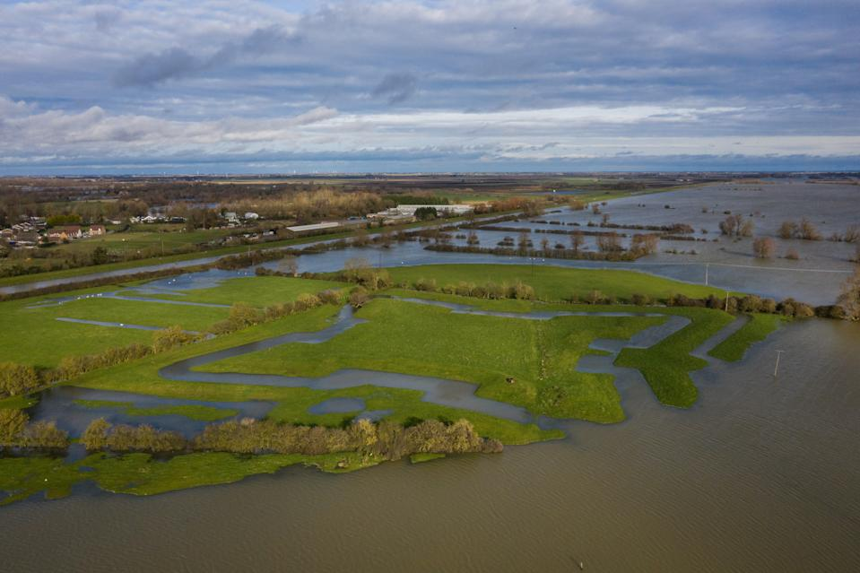 EARITH, UNITED KINGDOM - JANUARY 19: The outlines of the civil war fortifications at Earith Bulwark are visible due to flood waters on January 19, 2021 in Earith, United Kingdom. Storm Christoph is the first named storm of 2021 with heavy rainfall bringing flooding areas of the UK including Cambridgeshire, Greater Manchester and South Yorkshire. (Photo by Leon Neal/Getty Images)