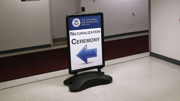 PHOTO: Signage beacons immigrants and their families to a naturalization ceremony on Feb. 2, 2018 in New York. (John Moore/Getty Images, FILE)
