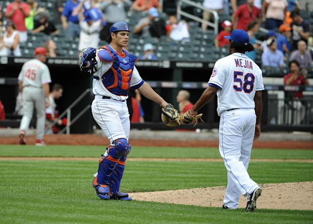 New York Mets catcher Anthony Recker, left, celebrates his team's 6-5 win over the Philadelphia Phillies with relief pitcher Jenrry Mejia (58) after a baseball game on Sunday, Aug. 31 2014, in New York. Recker hit a three-run home run during the game. (AP Photo/Kathy Kmonicek)