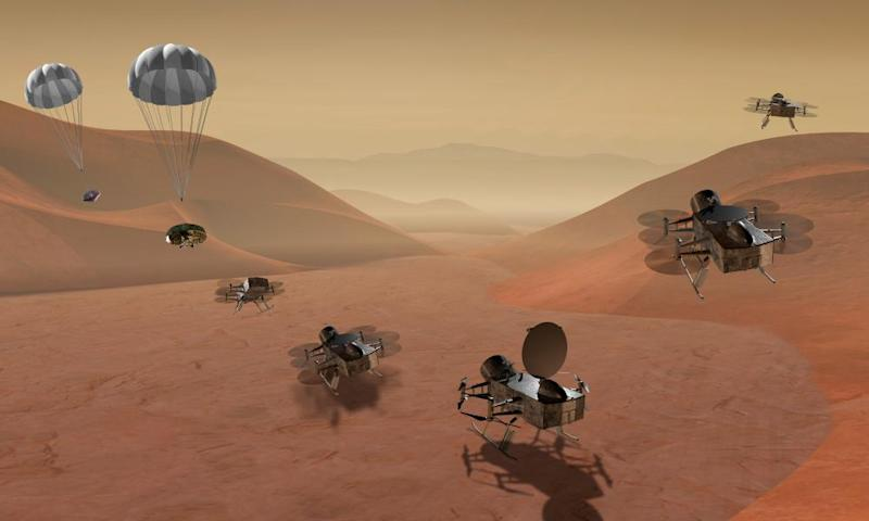 An artist's rendering shows multiple views of the Dragonfly dual-quadcopter drone that will explore Saturn's moon Titan.