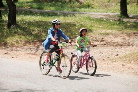 A woman and her daughter ride bicycles as they part in Girls on Bike rally in Islamabad, Pakistan, April 2, 2017. REUTERS/Faisal Mahmood