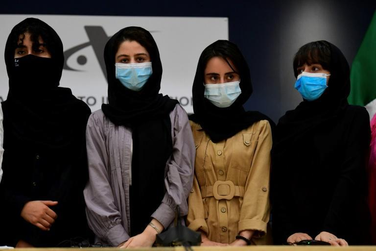 Four members of an Afghan robotics spoke to the press after fleeing their Taliban-controlled country for Mexico